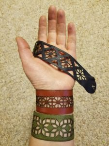 Laser-cut leather cuffs